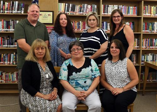 Board of Education Members posing in the school library